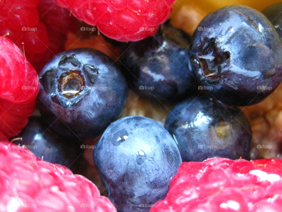 Berries. Up-close photo of organic blueberries and raspberries.