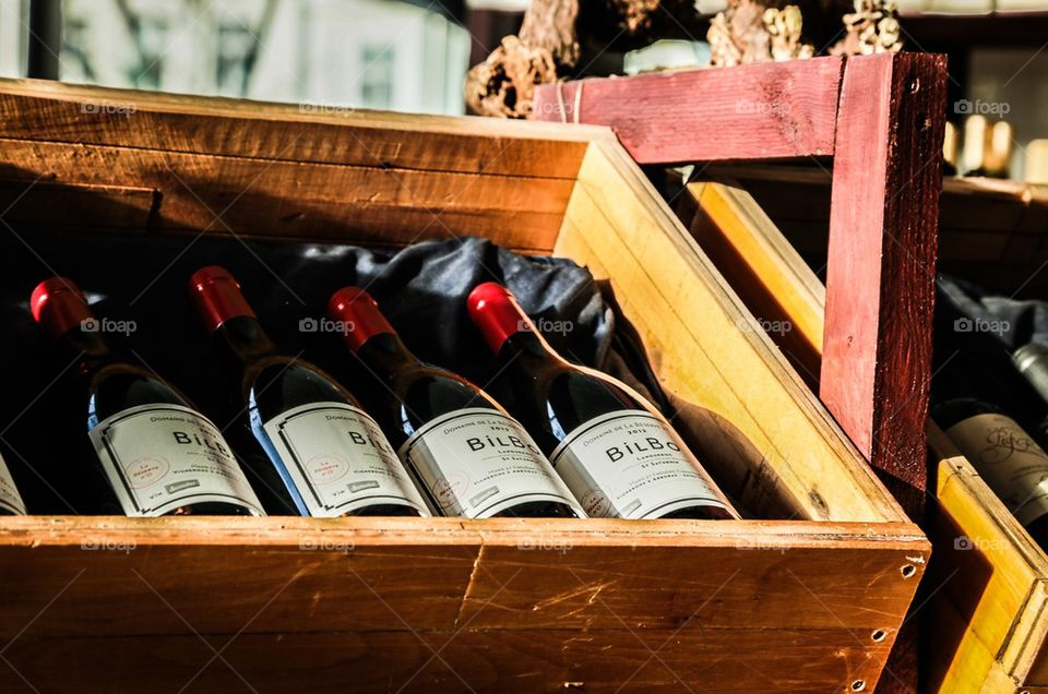 Red wine . Red wine bottles in a wooden box