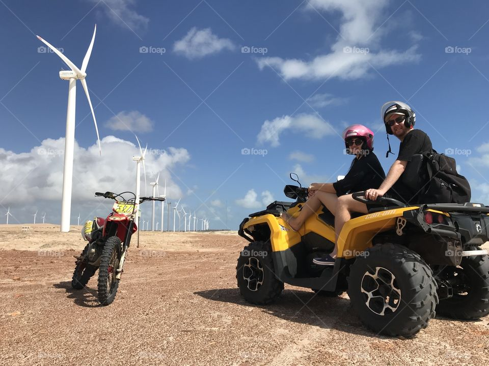 Couple having Fun with a quadbike at dunes Ceará Brazil