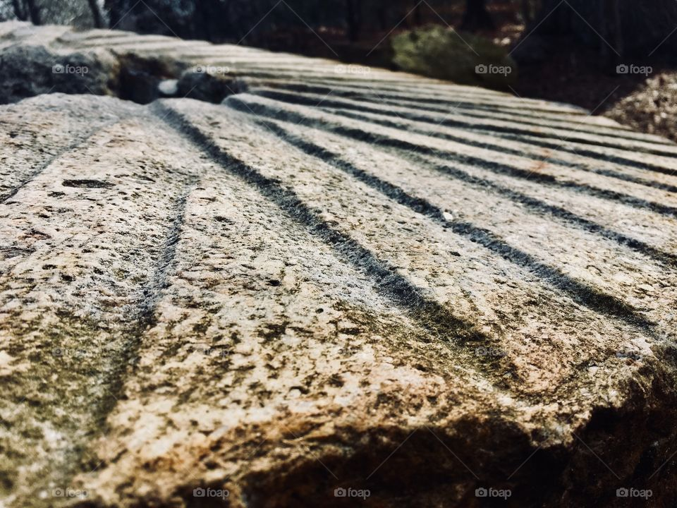 Closeup of a large grinding stone used to crush wheat and corn in an old gristmill many years ago