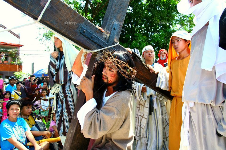 catholic devotees reenact the death of jesus christ on good friday during holy week in cainta, rizal, philippines, asia