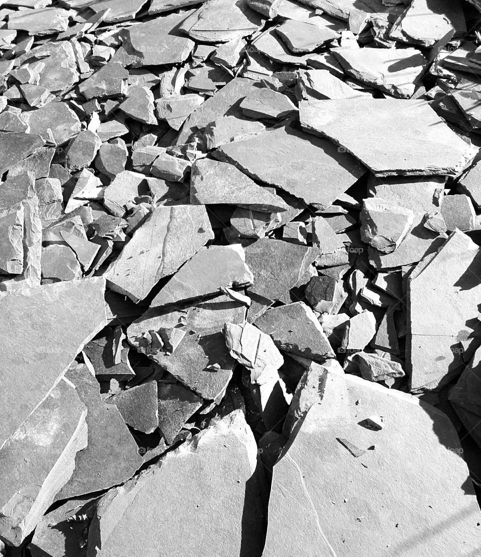 Grey slate chippings with shadows cast by strong winter sunlight