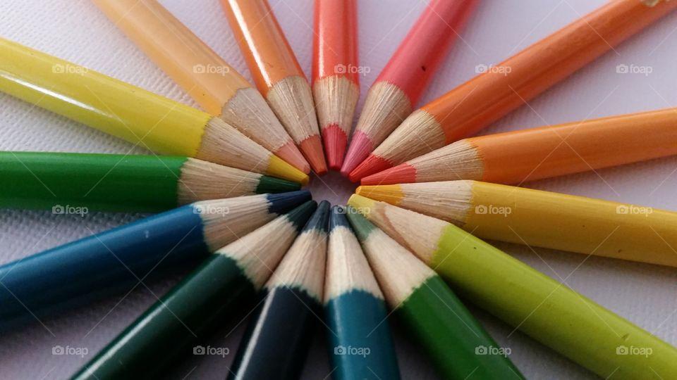 Multi colored pencils in a circle