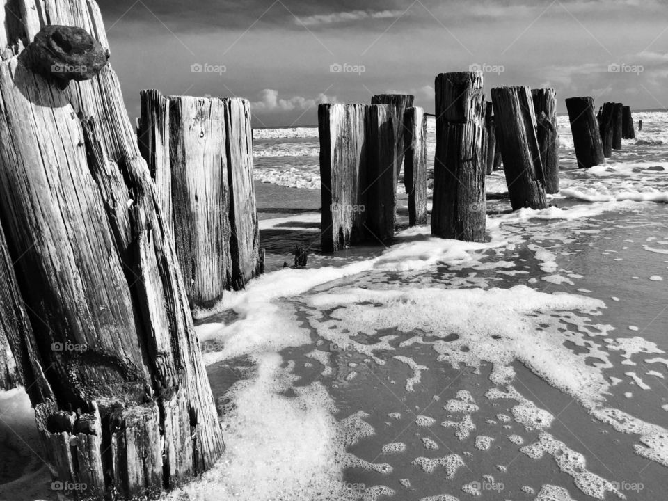 Black and White Photo of Foam and Tide on Folly Beach in South Carolina