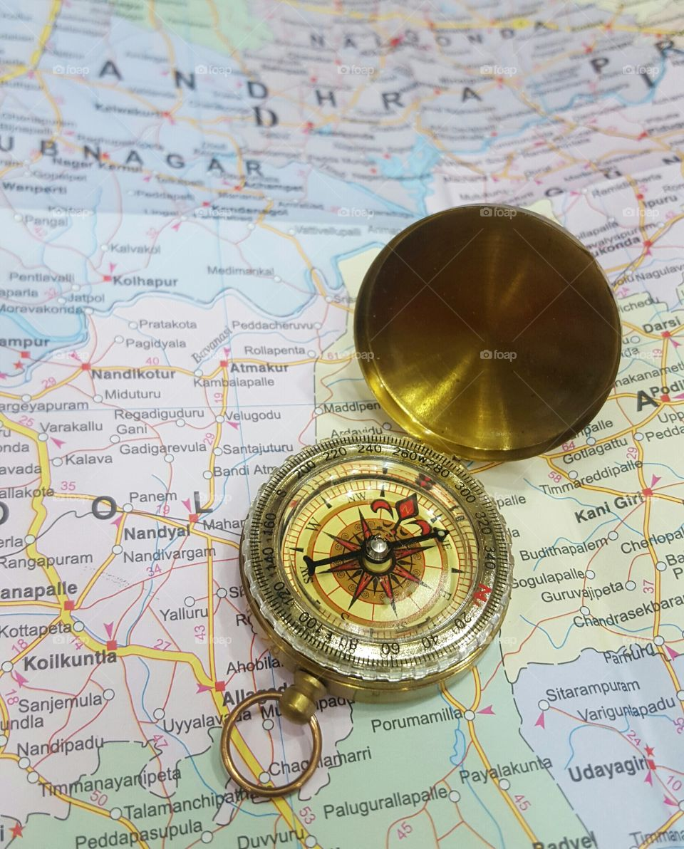Golden Vintage direction compass with lid  on a Map