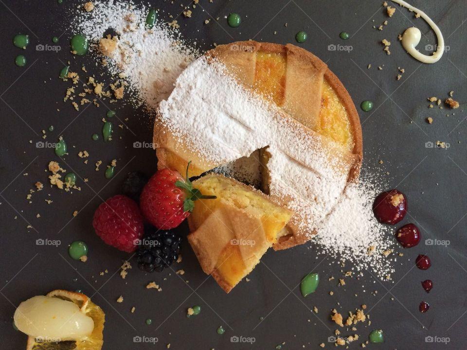 Crepe pancake with powdered sugar and fruits