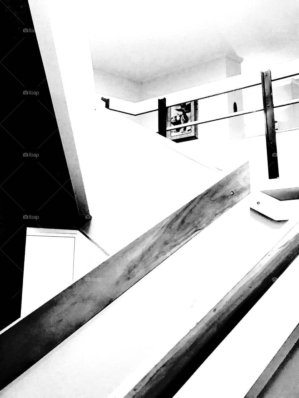 Architectural black and white photo of a stairway with a turn in it makes for a fun photo!