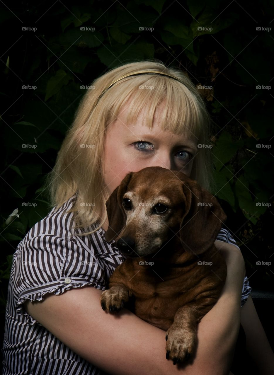 Portrait of a friend who does animal rescue. We adopted the dog from her shelter.