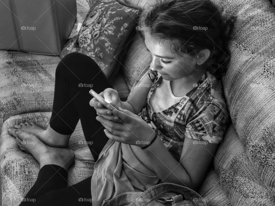 Young Girl Using A Mobile Device