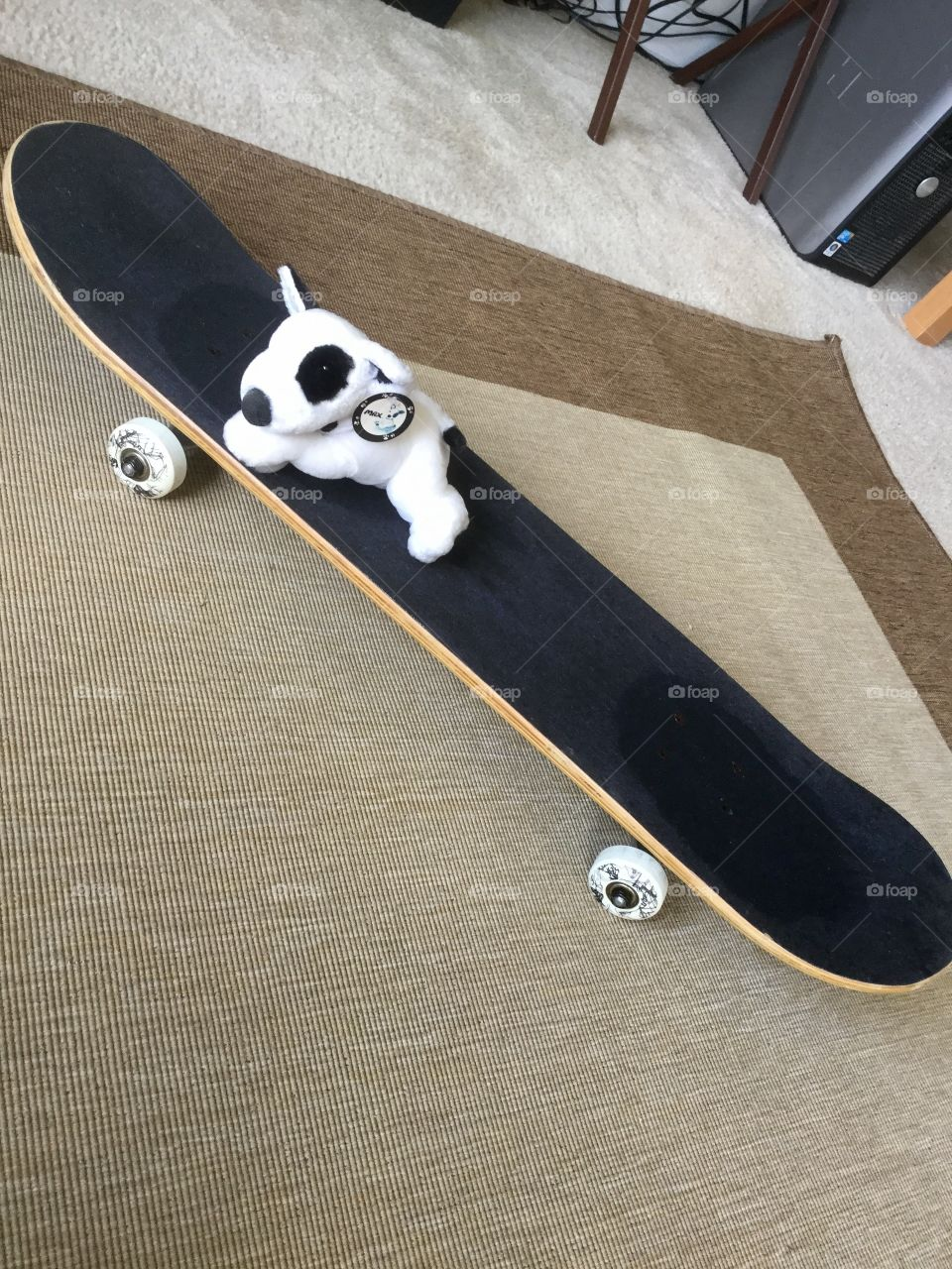X Games Skateboard with white  plush puppy
