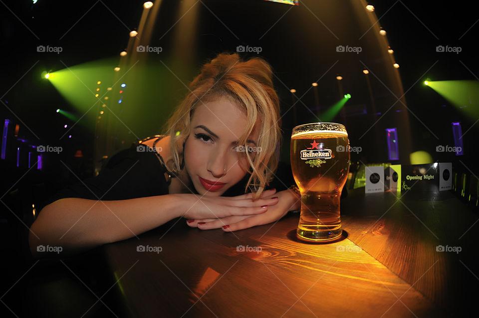 girl lights beer bay by yahavesh