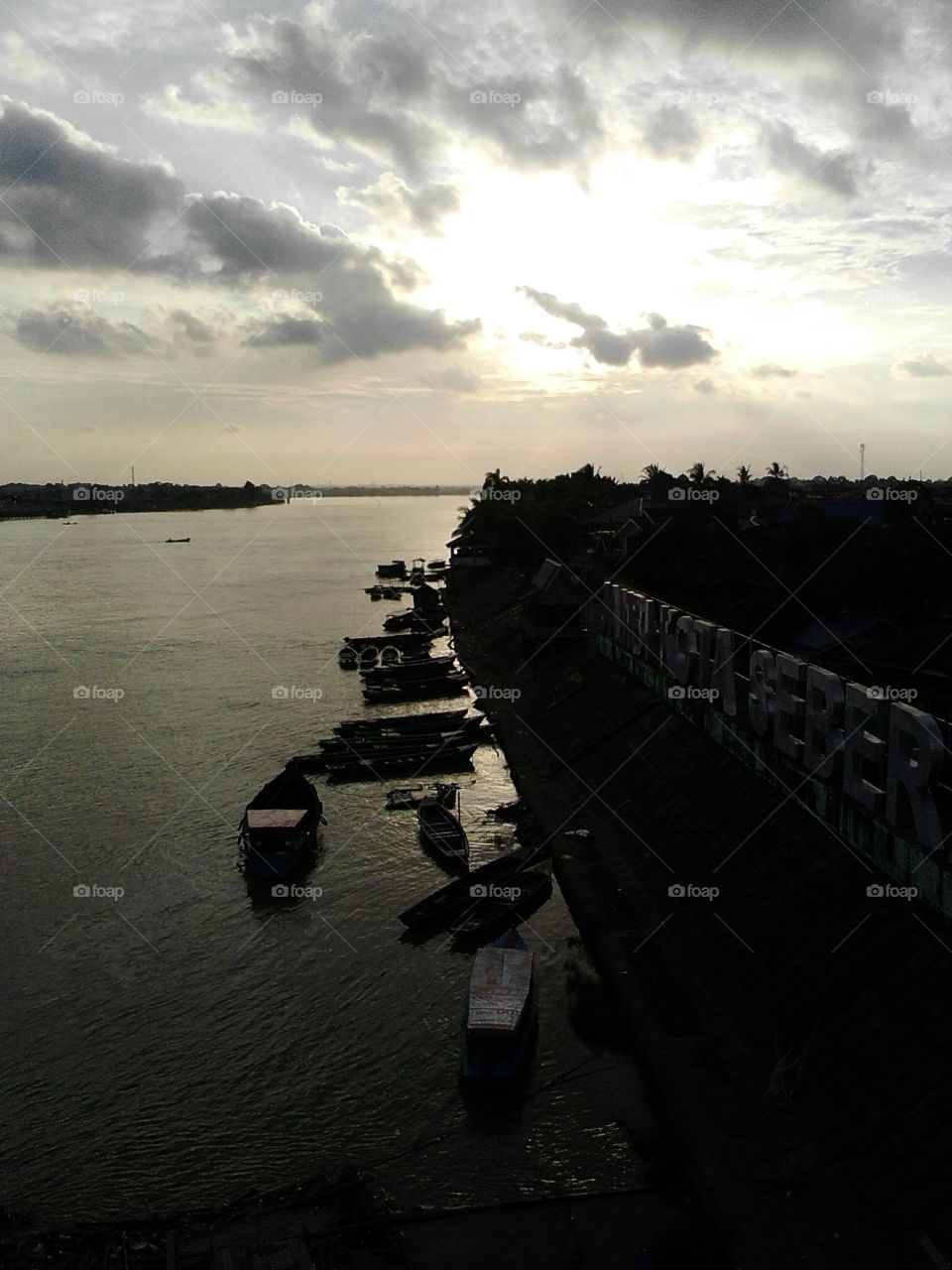 batanghari river in evening with sunset