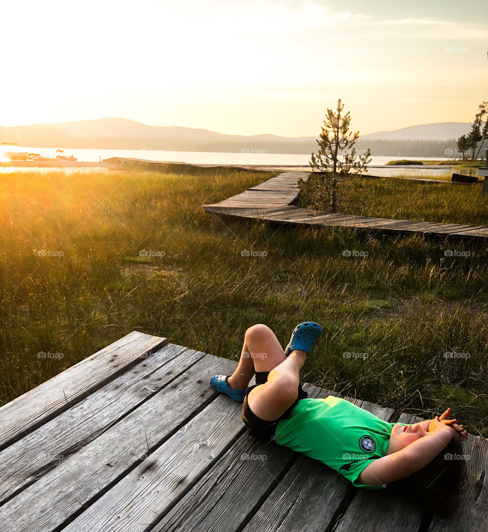 Basking in the evening sunlight next to the lake. Soaking in the moment and living the dream.