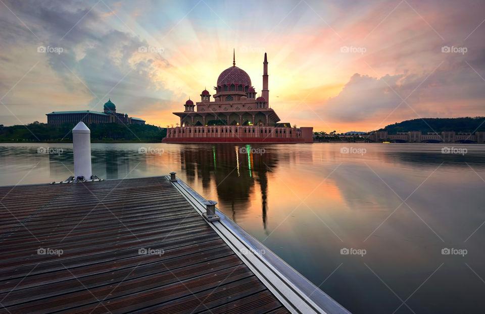 Blessing Sunrise. Sunrise reflections over Putra Mosque Putrajaya, Malaysia