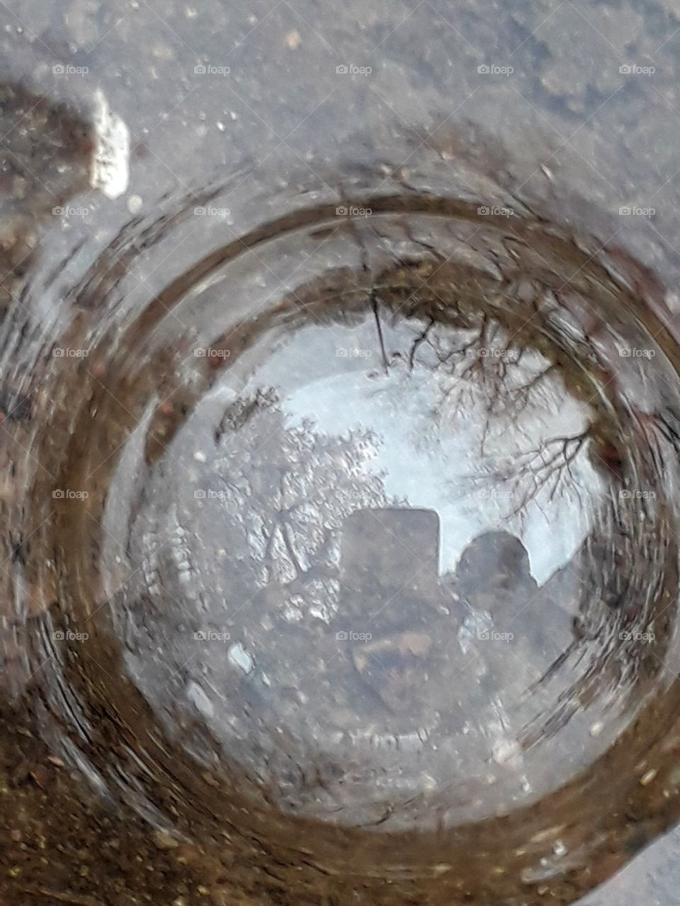 Rain water on the ground, reflection of rain water bubble