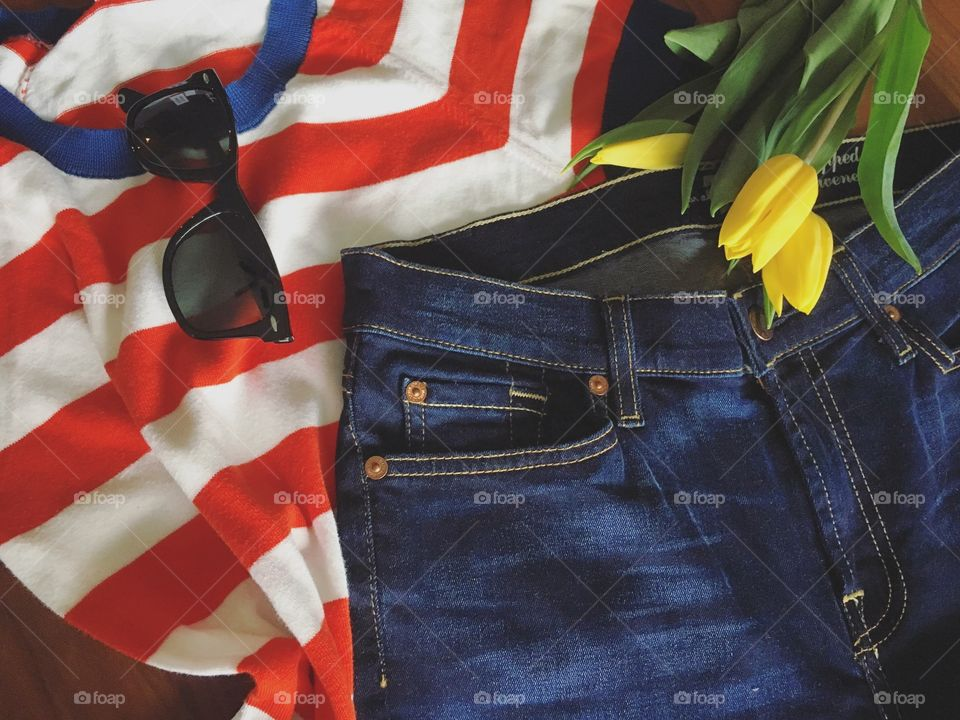 Demin jeans and sunglasses with flower
