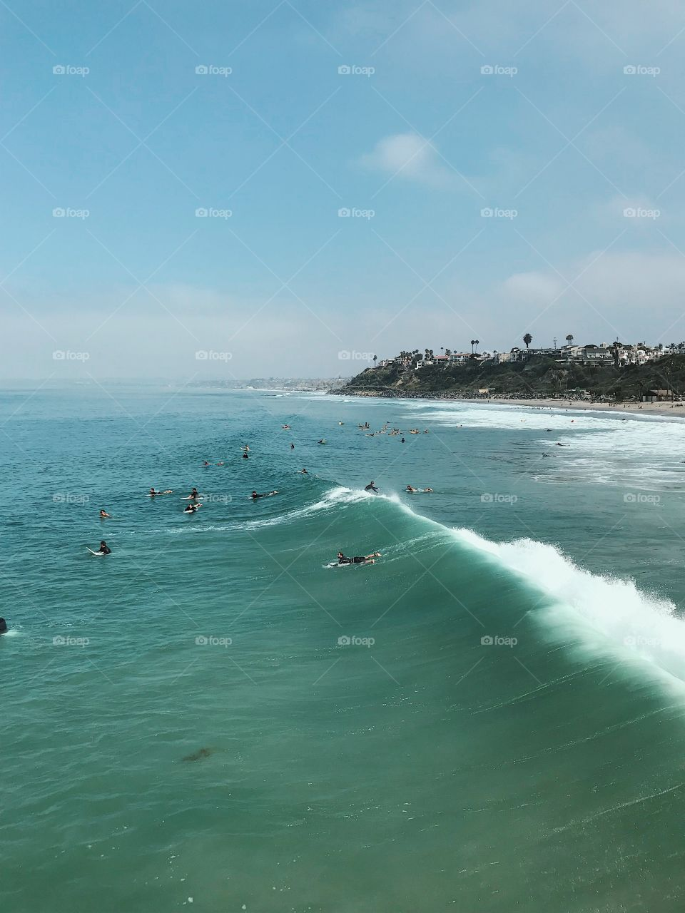 Beautiful afternoon at the beach watching the surfers catch some sweet waves on the west coast.