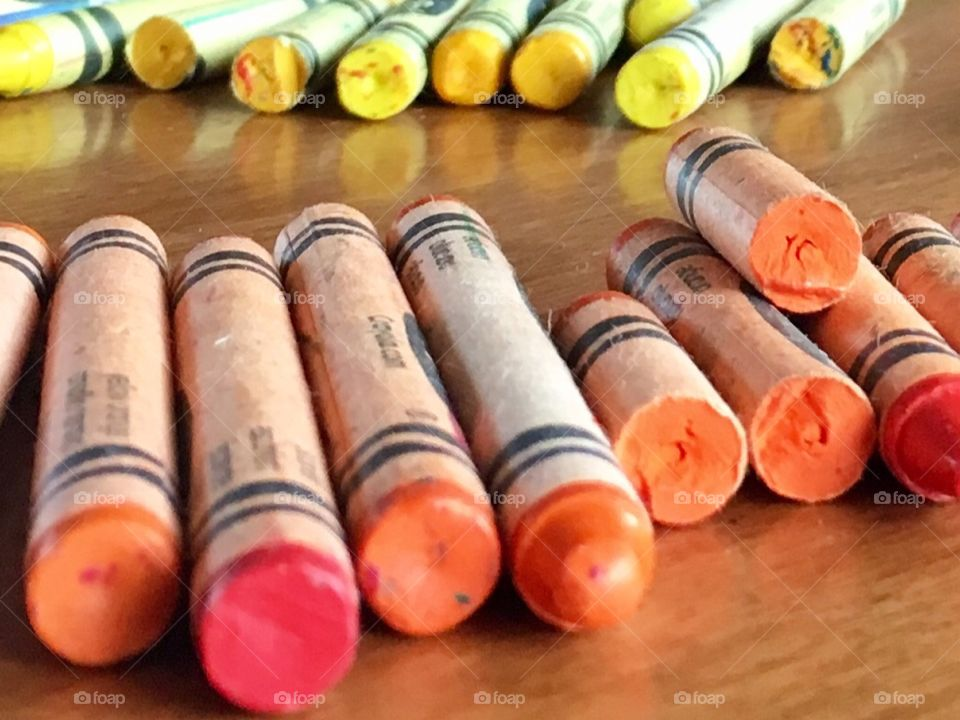 Crayons in red, orange and yellow tones.